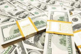 stock photo of 100 dollars dollar bill american paper money cash stack  - Ten thousand dollar stacks on money background - JPG