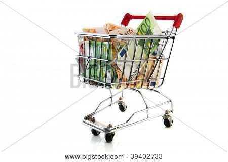 Expensive shopping cart with euro banknotes in different values isolated over white background