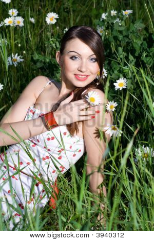 Beautiful Woman Sitting In Tall Grass & Daisies