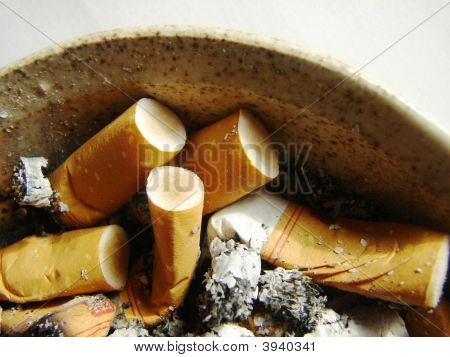 Cigarrettes And Ashtray