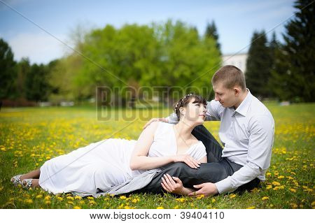 Girl and boy lying on the grass