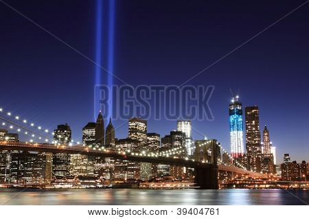 Brooklyn Brigde, Lowers Manhattan Skyline and the Towers Of Lights (Tribute in Light 9/11 memorial) at Night, New York CityNight