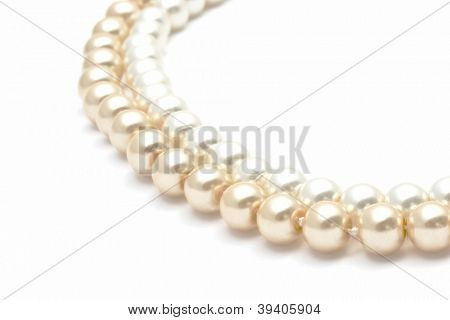 Beautiful pearl necklace closeup on white background