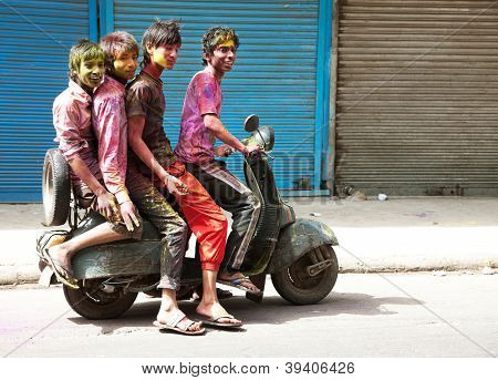 DELHI, INDIA - MARCH 08: People covered in paint on Holi festival, March 08, 2012, Delhi, India. Holi, the festival of colors, marks the arrival of spring, being one of the biggest festivals in India