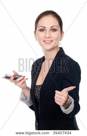 Business Woman With A Cell Phone Shows Thumb