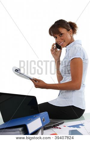 businesswoman talking on the phone in her office
