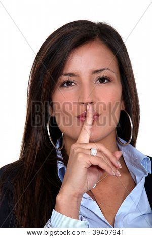 Businesswoman gesturing for silence