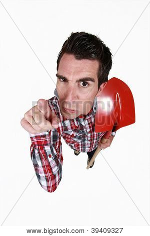 Angry tradesman pointing his finger in blame