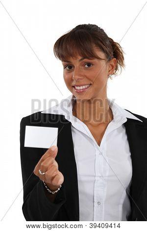 Brunette brandishing business card