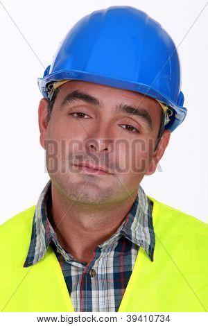 Portrait of bored laborer