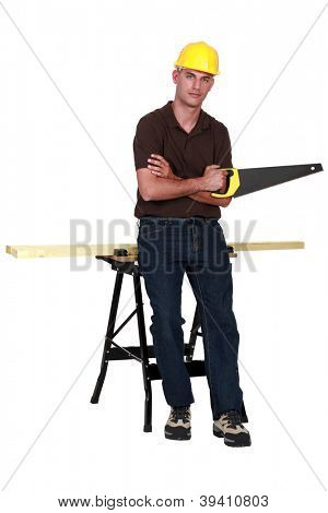 Carpenter with a handsaw