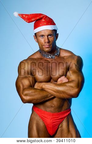 Strong Athletic Man In A Cap Of Santa Claus