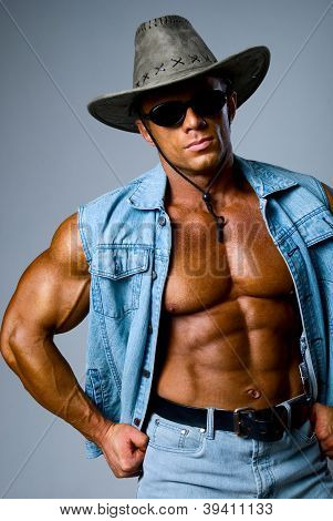 Handsome Muscular Man In A Cowboy Hat