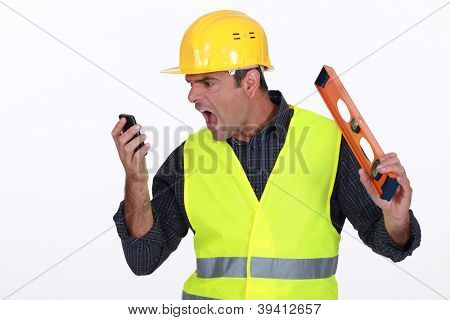 Irate builder shouting down phone