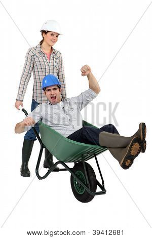 Workers with a wheelbarrow