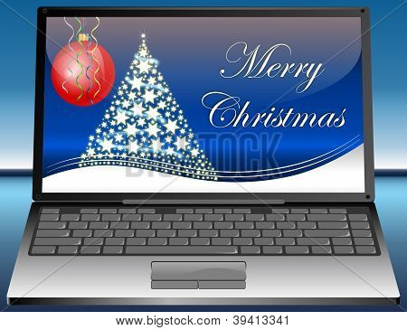 Laptop with Merry Christmas card