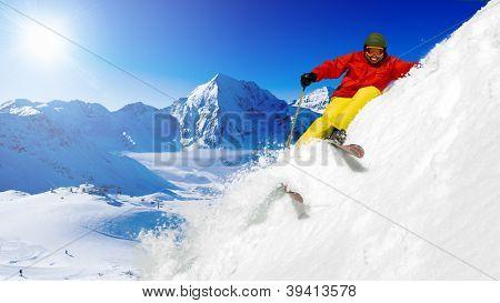 Skiing, Freeride in fresh powder snow - man skiing downhill