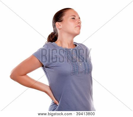 Unhappy Young Woman With A Terrible Back Pain
