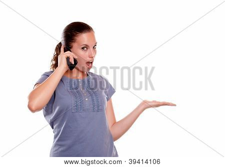 Surprised Young Woman Speaking On Mobile Phone