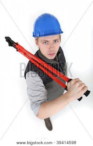 Menacing tradesman holding large clippers