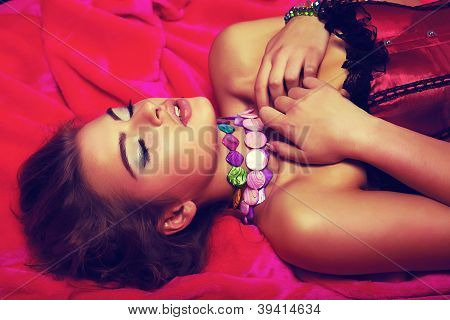 Dreamy Sensual Romantic Girl In Red Dress Lying In Bed