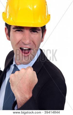 Man with helmet jubilant