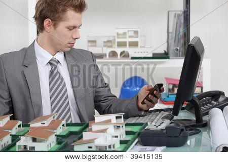 Sat at desk sending text message