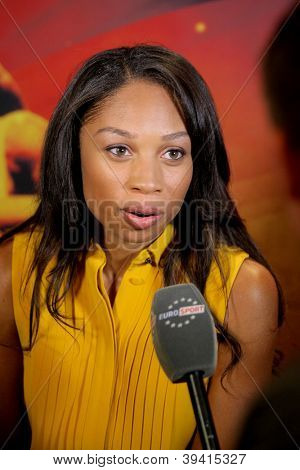 BARCELONA - NOV, 24: World champion athlete Allyson Felix interviewed by tv channel Eurosport during a Centenary of IAAF at Hotel pullman on November 24, 2012 in Barcelona, Spain