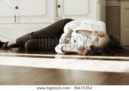 Beautiful woman lying on the floor at apartment