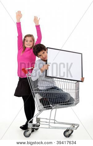 Two kids with trolley