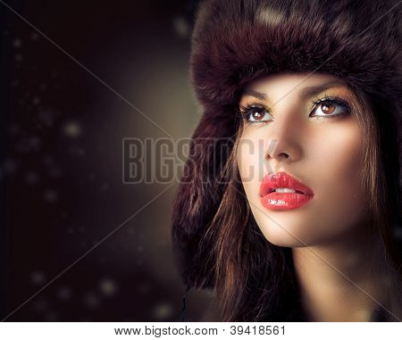 Beauty Fashion Model Girl in a Fur Hat. Beautiful Stylish Woman Portrait.Winter Style Girl.