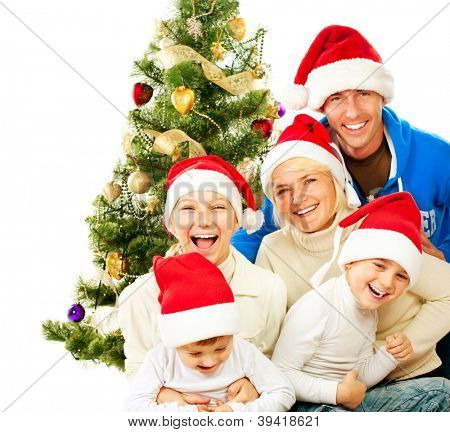 Happy Christmas Family. Big Family with Kids Celebrating Christmas. New Year. Christmas Tree. Smiling Children and Parents isolated on a White Background