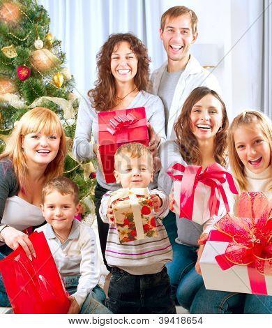 Happy Big family with Christmas presents at home.Christmas tree. New Year Gifts