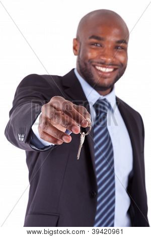 Young African American Businessman Holding A House Key.