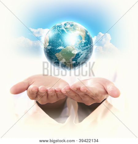 Planet System in Your Hand. Conceptual Image. Elements of this image are furnished by NASA
