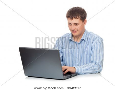 Young Adult Businessman Working With Laptop