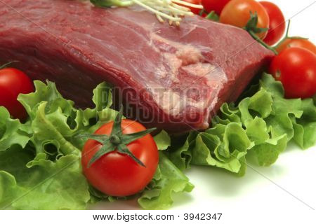 Raw Beef Meat On Green Salad