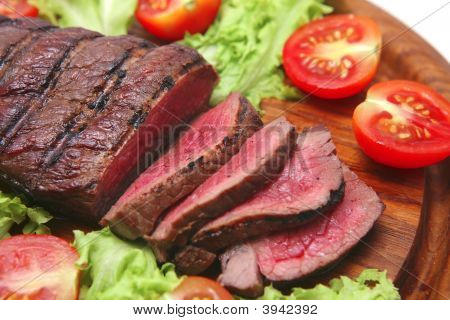 Red Beef Meat On Wooden Plate