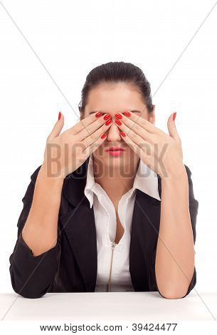 Business woman covering her eyes