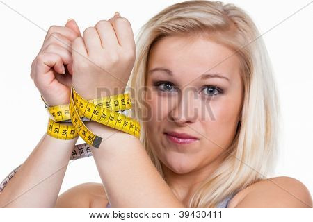 a young woman with a tape measure before the next diet. removing fast and