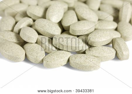 Multivitamins Oval Tablets Isolated On White