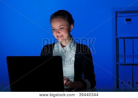 portrait of a woman in a night office