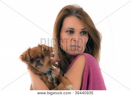 Portrait Of Young Attractive Blonde Woman Holding Little Dog On Her Hands