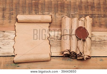Scrolls of vintage paper with seal wax