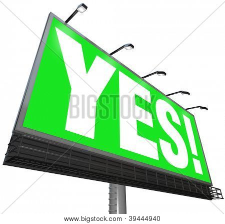 The word Yes on a green outdoor advertising billboard sign to communicate approval, positive answer, acceptance, passing grade or review