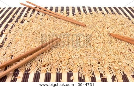Rice And Chopsticks On Bamboo Carpet