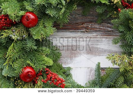 Christmas garland on a rustic wooden background.