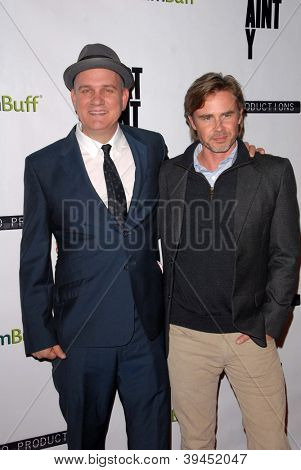 LOS ANGELES - NOV 27:  Mike O'Malley, Sam Trammell arrives at the 'Certainty' Los Angeles premiere at Laemmle Music Hall on November 27, 2012 in Beverly Hills, CA