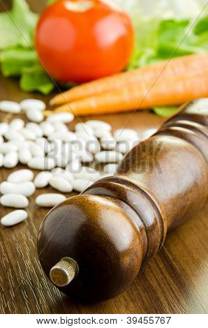 Pepper Mill And Raw Vegetables