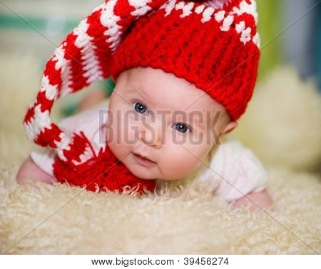 baby  girl  in a red hat